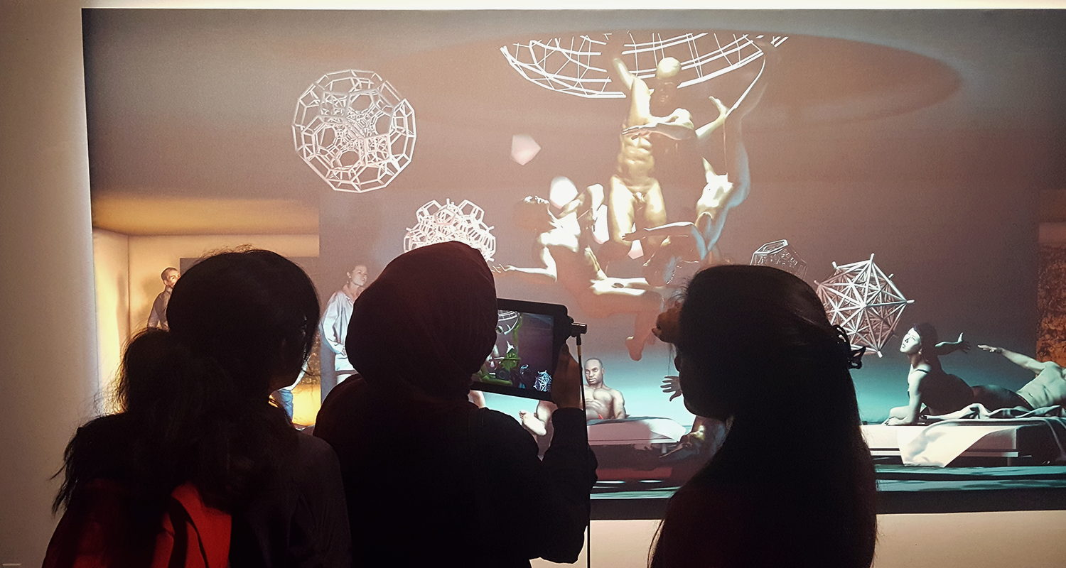 People using The Merging app to view AR elements of the mural painting.