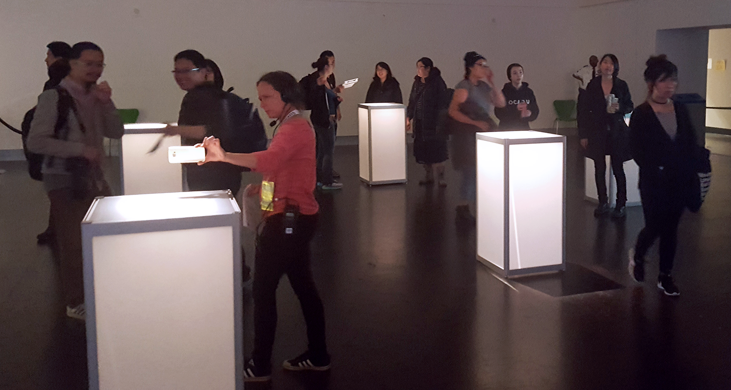 Half of the interior exhibit features standing plinths with AR markers set on top for scanning.